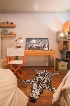 Tapete Zebra ivory/Black no ambiente da loja Quartos&Etc